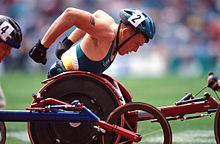 220px-301000_-_Athletics_wheelchair_racing_Kurt_Fearnley_action_3_-_3b_-_2000_Sydney_race_photo